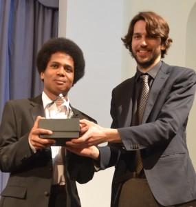Adam Heron receives the Hewitt-Jones Trophy from Thomas Hewitt-Jones.
