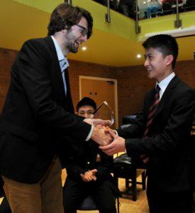 Bill Ko Tsz Hin receives the Hewitt-Jones Trophy from Thomas Hewitt-Jones