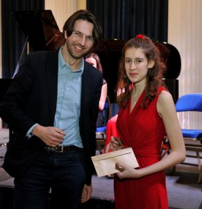 GYM 2020 winner Darcy Beck receives the Hewitt-Jones Trophy from composer Thomas Hewitt-Jones